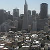 San Francisco's Transamerica Pyramid and Financial District loom over North Beach District.