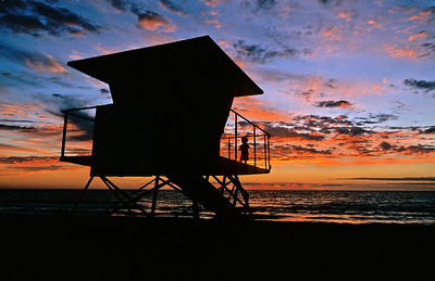 This is one of my favorite photos. I had this lifeguard tower and a beautiful sunset all ready to capture but my composition was missing one element. When a young boy and his father walked by, I knew what I was missing. Taken with my old Nikon F5 and 17-35 f/2.8 lens on Fuji Velvia.