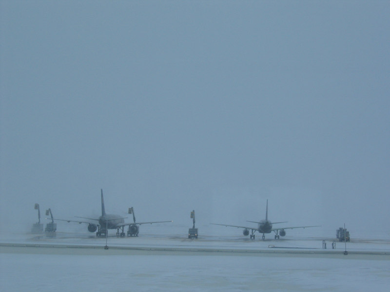 Planes being deiced at DIA