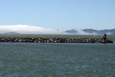Fog rolling in over the Golden Gate bridge and Alcatraz