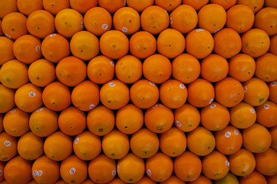 At the fruit stand: oranges.