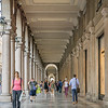 Many of the streets in Turin have porticoes to  cover the shop sidewalks.  You are outdoors, but protected from the sun or rain.
