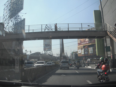 "Behind the walkway is the Bonifacio Monument (sorry for poor picture, but see video)..bonifacio monument http://www.tumblr.com/tagged/bonifacio-monument   Philippine Trip 2012 Pt 37 ""Bug & Drive from Metro Manila: Valenzuela to Binondo"" https://youtu.be/EPd9lOqP7A4"