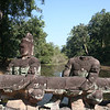 Crossing the pool outside of Preah Kahn. The bridge depicts the Samudra Manthan story.