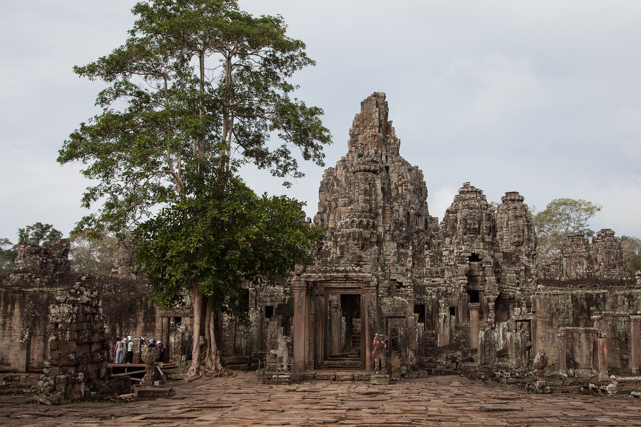 A view of the entrance to Bayon, at the center of the city of Angkor Thom. This temple was built around 1200AD and has over 200 large faces on 54 towers.