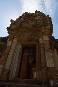 Carvings in a doorway at Chau Say Tevoda, from the early 12th century. The temple was restored by a team from China, so some of the structure is patched with concrete.
