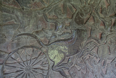 A head-on view of one section of bas-relief. The polished appearance is due to either many, many hands touching the stone, or to lacquer being applied.