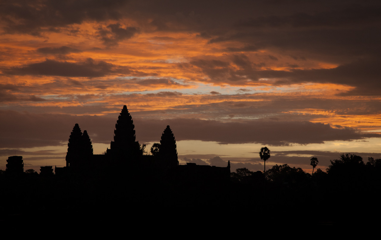 Sunrise over the silhouette of Angkor Wat.