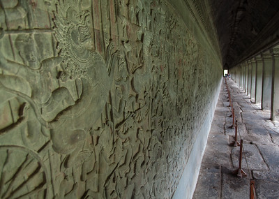 Some of the incredible bas-reliefs carved into the outer walls of Angkor Wat. These bas-reliefs depict Indian epics, history of war during the Angkor period, or sacred books. The carvings cover nearly 13,000 square feet (1,200 square meters) of sandstone.