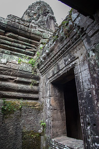 A view from down below the main level of Bayon, looking back up to one of the towers.