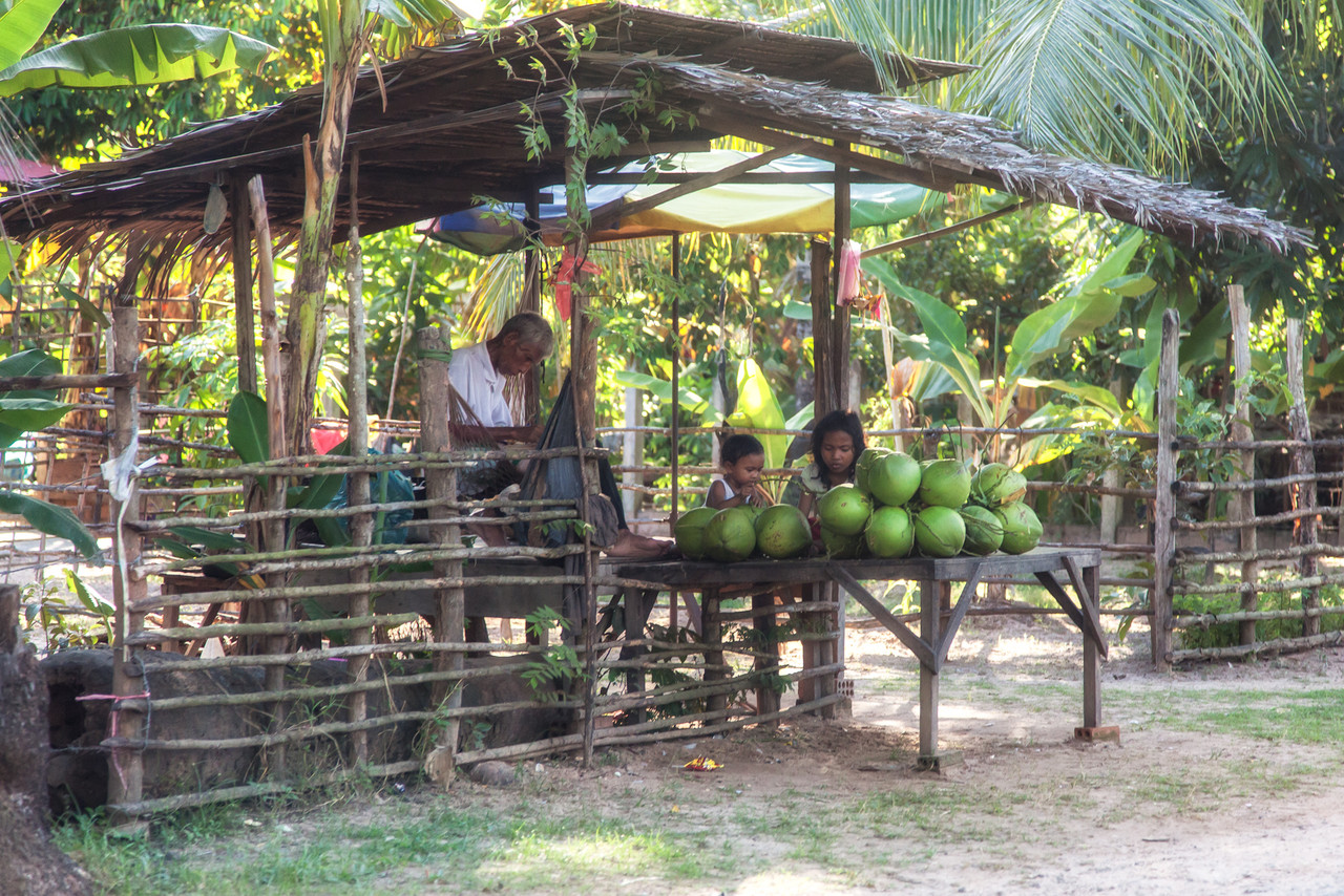 A fruit stand along the side of the road.
