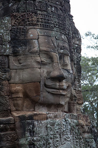 A close-up of one of the faces of Bayon.