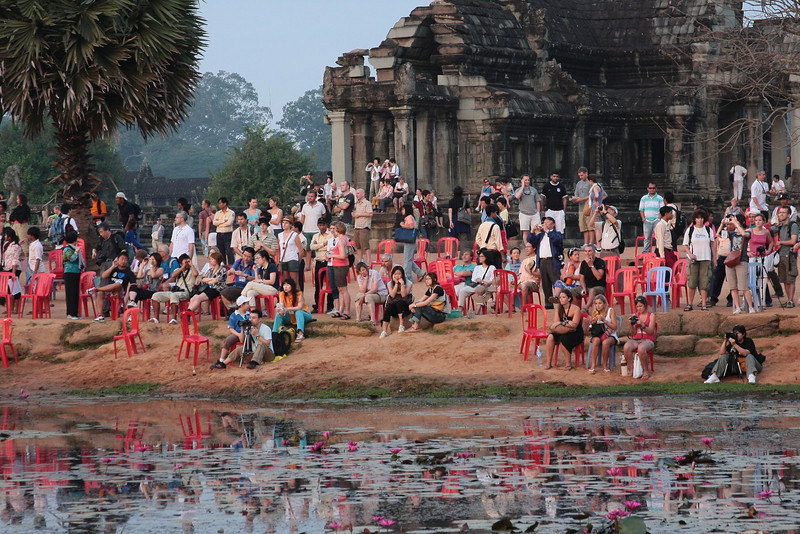 people watching Angkor Wat