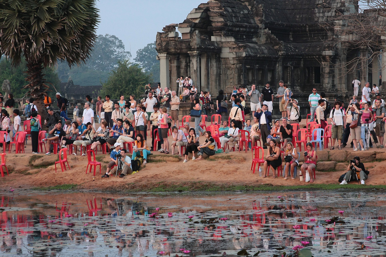 people watching Angkor Wat