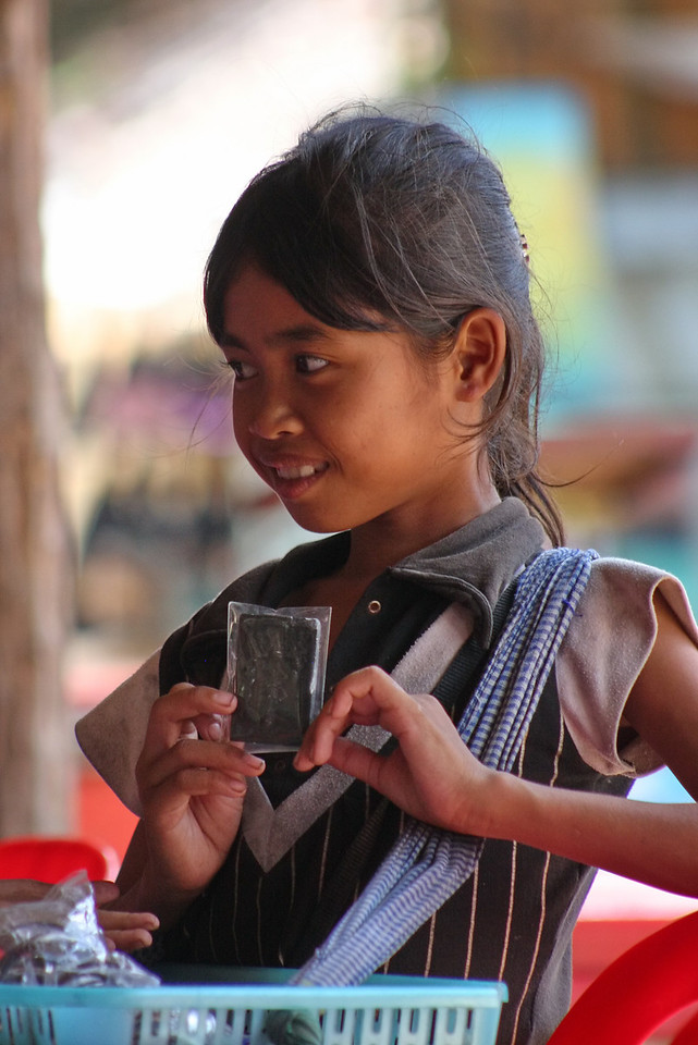 girl selling postcards