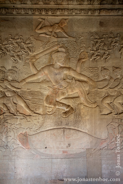 Churning of the Sea of Milk Bas-relief Decoration - Vishnu in the centre, his turtle Avatar Kurma below, asuras and devas to left and right, and apsaras and Indra above