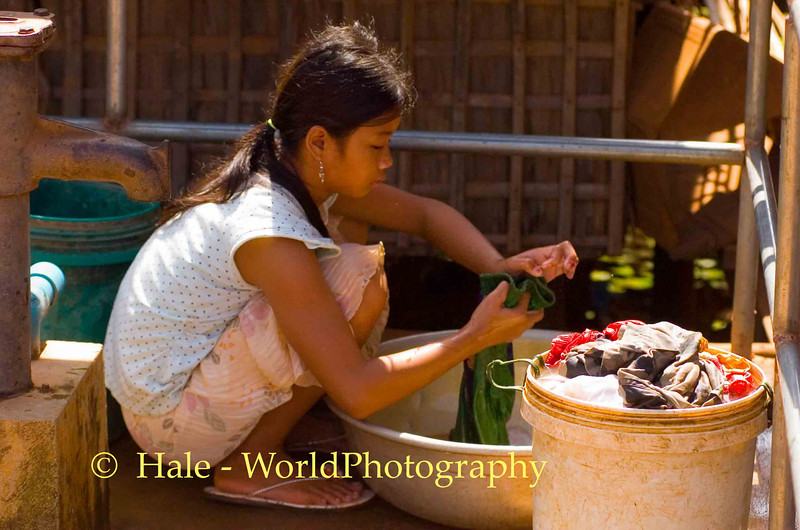 The Clothes Washer In Chong Khneas, Cambodia