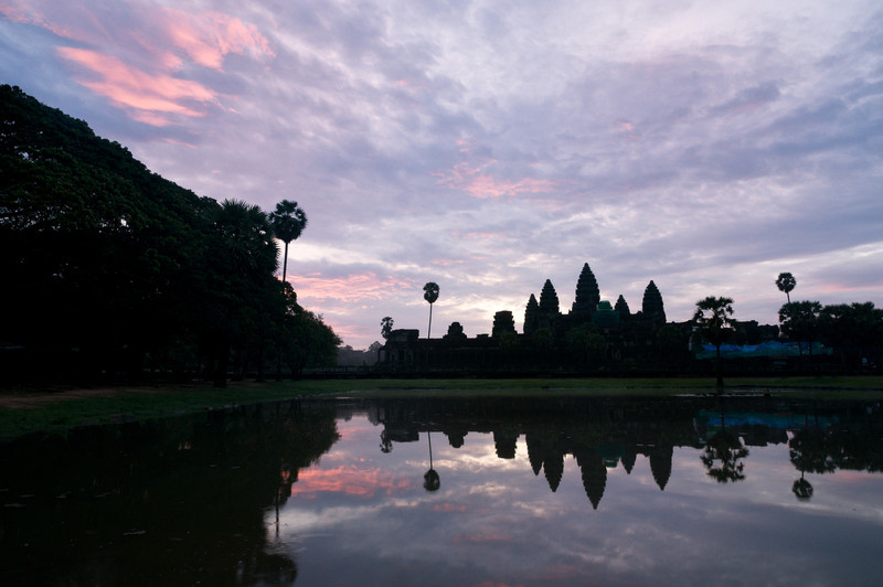 Angkor Wat at dawn. Built in the 12th century as a Hindu temple, it is now Buddhist and stands as the world's largest religious building.