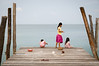 Children fish for their dinner at the end of one of Koh Roung's piers. The future is yet unsure for those on Koh Rong. Big developments are ahead and only time will tell whether the Royal Group will move the village to make way for beach resorts.
