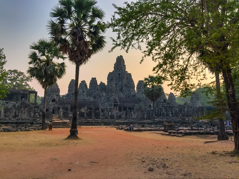 Bayon Temple, Angkor, Cambodia<br /> <br /> Bayon was the state temple of Jayavarman VII, a powerful ruler in the late 13th century. The temple sat at the center of Angkor Thom, a walled city that served as the capital of the Khmer Empire. Four of the city's five gates sat on axis with the temple, and the walls of the city substituted for the enclosure walls normally found at Khmer temples. The walls sit at such a distance from the temple that the temple seems to rise abruptly from the ground like an artificial mountain. In fact, the temple was intended to evoke the form of Mt. Meru—the cosmic mountain at the center of the world in Buddhist cosmology. In keeping with this cosmic symbolism, the plan of the temple is based on a 'yantra', a symbol used by Tantric Buddhists as the basis of mandala diagrams that represent the layout of the universe. The temple honored not just one deity, but a host of gods found throughout the Khmer empire. Its central shrine held an image of Jayavarman VII, who perhaps imagined himself as a god-King ruling in the name of the Buddha.<br /> The temple is best known today for the gigantic face sculptures that adorn its thirty-seven surviving towers. Facing in four directions on each tower, the faces are thought to represent Lokeshvara, a Buddhist deity that projected benevolence outward to the four directions.