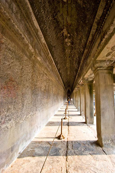 Exterior walkway. Wall on left is covered with bas reliefs depicting Angkor history.