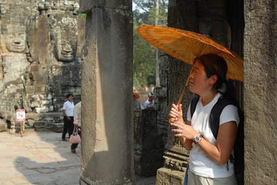 © Joseph Dougherty. All rights reserved.   Seeking refuge from the blazing sun amid the ruins of Bayon.