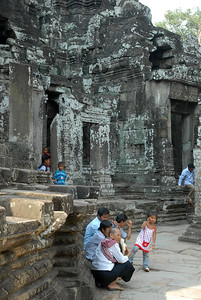 © Joseph Dougherty. All rights reserved.   Cambodian visitors touring the ruins at Bayon