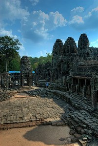The Bayon's most distinctive feature is the multitude of serene and massive stone faces on the many towers which jut out from the upper terrace and cluster around its central peak.