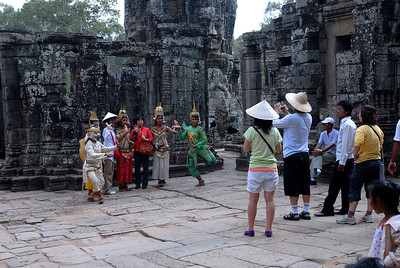 © Joseph Dougherty. All rights reserved.   Cambodian dancers pose with visitors in the Bayon ruins.