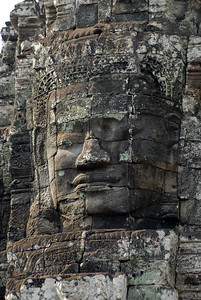 © Joseph Dougherty. All rights reserved.   The similarity of the 216 gigantic faces on the temple's towers to other statues of the king has led many scholars to the conclusion that the faces are representations of Jayavarman VII himself. Others have said that the faces belong to the bodhisattva of compassion called Avalokitesvara or Lokesvara.