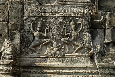 © Joseph Dougherty. All rights reserved.   Dancing figures decorate a pillar of stone at Bayon