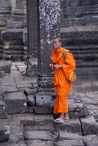 © Joseph Dougherty. All rights reserved.   Young Buddhist monk touring the ruins of Bayon, with his digital camera.