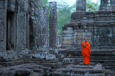 © Joseph Dougherty. All rights reserved.   A microcosm of anachronism:   a young Buddhist monk in the ruins of Bayon, speaking on his cell phone.