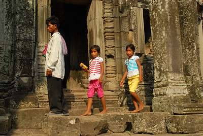 © Joseph Dougherty. All rights reserved.   Cambodian man visiting the ruins with his daughters.