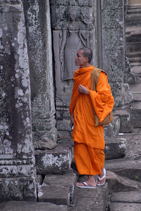 © Joseph Dougherty. All rights reserved.   Young Buddhist monk touring the ruins of Bayon.