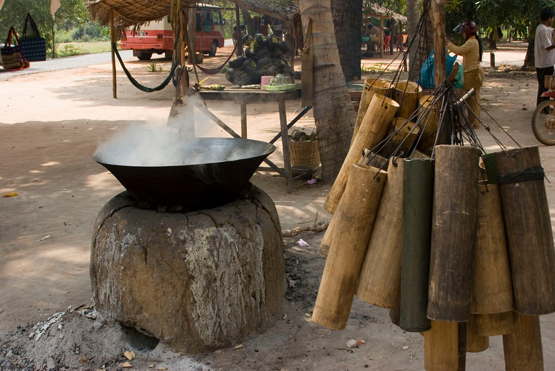 Brewing Sugar from Tree Sap<br /> Juice is collected in bamboo tubes