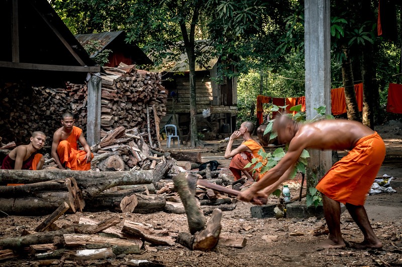 Monks in Angkor Thom monastery chopping wood