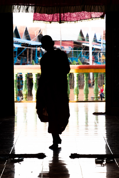 Young monk in pagoda in the stilted village of Kampong Phluk