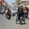 Riding through the back streets of downtown Phnom Penh.