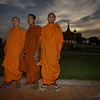 Three monks pose for their photo.