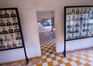 Rows of photos  depicting a small number of the thousands of Khmer Rouge Victims fill many rooms, at the Tuol Sleng (S-21) Genocide Museum - Phnom Pehn, Cambodia