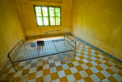 Empty torture room, amunition box and bed at the notorious Tuol Sleng Genocide Museum - Phnom Pehn