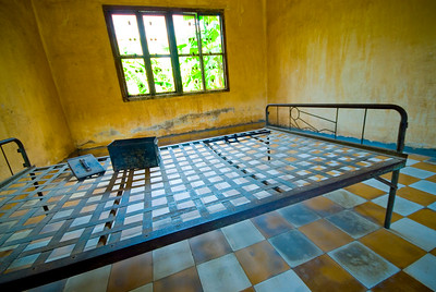 Torture room, amunition box and bed at the notorious Tuol Sleng Genocide Museum - Phnom Pehn, Cambodia