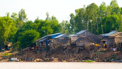 Fishermans houses on the Mekong River - Cambodia