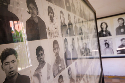 Rows of photo depicting a small number of the thousands of Khmer Rouge Victims at the Tuol Sleng (S-21) Genocide Museum - Phnom Pehn, Cambodia