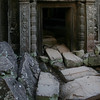 Tumbled masonry in shadowed doorway, Ta Phrom Temple, Siem Reap, Cambodia.