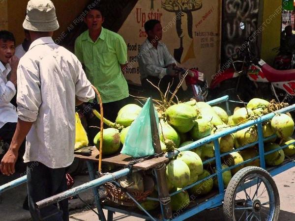 Cambodia - Phnom Penh - city - street scenes - melon seller and wheelbarrow