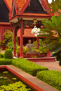 A flower and Buddha in the courtyard