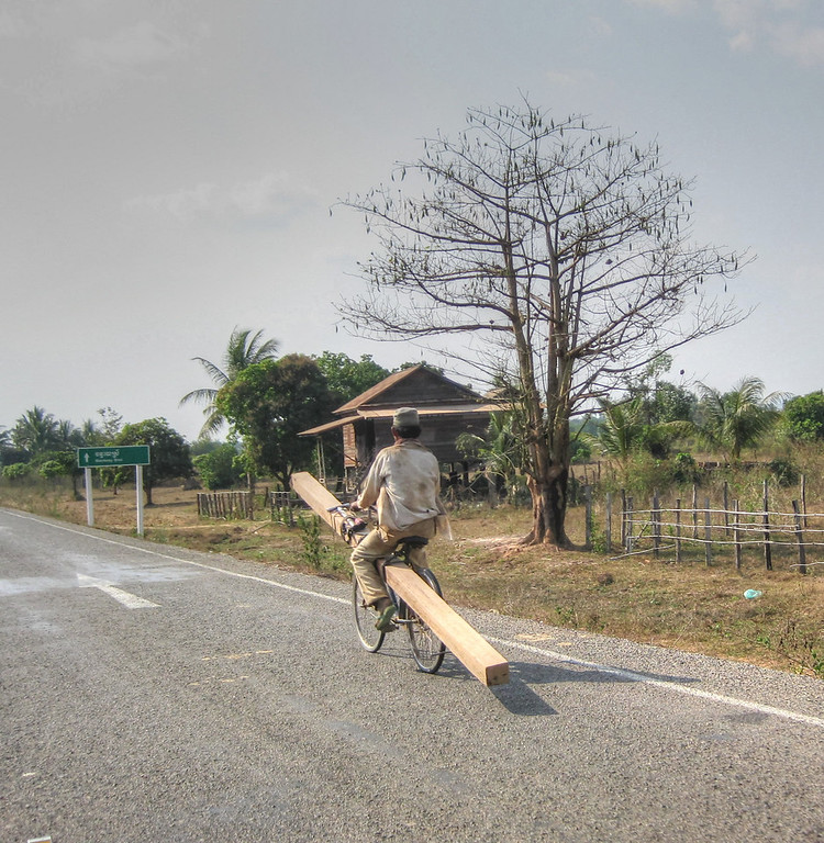 There were a whole bunch of these guys pedaling their bikes with the huge wood posts. Cambodia.