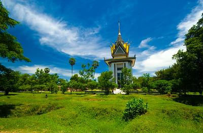 Pagoda and former mass graves at Choeung Ek Killing Fields - Phnom Penh Cambodia